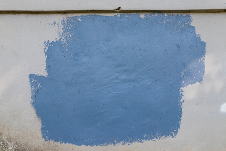 Texture of the wall for background. Roughness and irregularity. Uneven square of blue paint Stok Fotoğraf