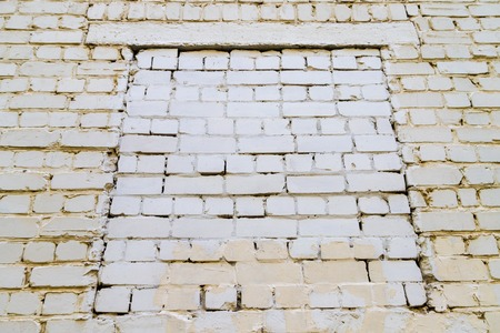 Texture of the wall for background. Roughness and irregularity. Window from brick Stok Fotoğraf