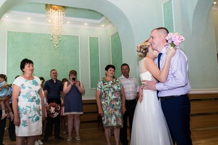 Kirov, Russia - June 29, 2018: Bride and groom dancing during the marriage ceremony in registry office Редакционное
