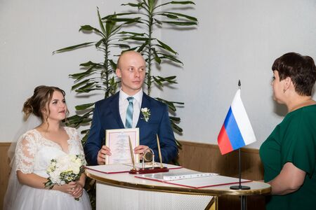 Kirov, Russia - July 27, 2018: Bride and groom befory ceremony of registration marriage in registry office Редакционное
