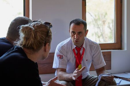 Marmaris, Turkey - May 23, 2018: Guide at an information meeting with tourists at a hotel in Turkey in Marmaris
