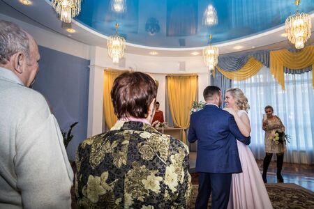 Kirov, Russia - October 12, 2018: Bride and groom dancing during the marriage ceremony in registry office Редакционное