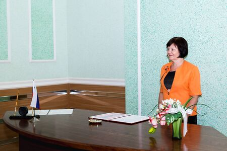 Kirov, Russia - June 29, 2018: Registry office of marriage and female manager of the registrar's office in it Редакционное