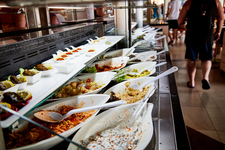 Food on the shelves in the self-service buffet with all inclusive in the hotel in Turkey