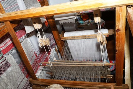 The weaving workshop and the loom there. National craft in Belarus in manor Dudutki
