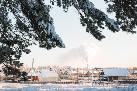 Village covered with snow in cold winter evening