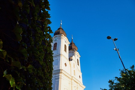 The two clock towers of the famous Benedictine Monastery of Tihany Abbey in a summer evening