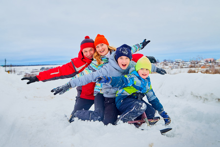 Portrait of a family with four people having fun in the snow Reklamní fotografie