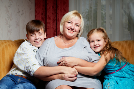 Adult mother and her young daughter and son at home. Reklamní fotografie