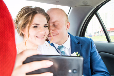 Russian bride and groom inside of the car Stock Photo