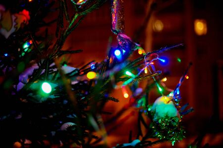 Christmas tree lights in night time. The photo is partially blurred Reklamní fotografie