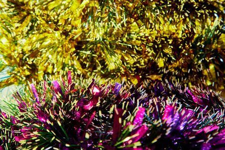 Colorful Christmas tinsel lined with rows. Texture and background