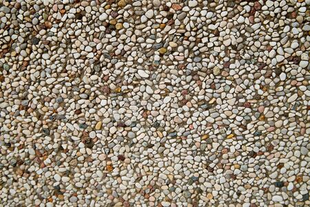 Stone asphalt texture of road in a day. Grey asphalt road and gravel. Background pebble and gravel