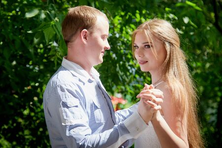 Young man and woman couple walk in the park. Spring or summer love story. Young happy family Imagens