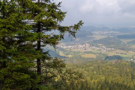 Mountain landscape with valley below. View from height on summer day Imagens