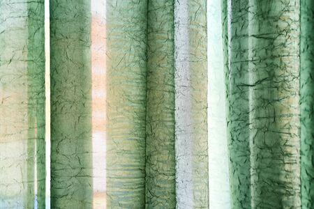 Vertical textile window curtain. Stripes background. Textile texture. Green colour