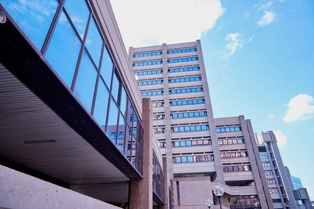 Facade of a multi-storey building. Fragment of wall of house and sky background 版權商用圖片
