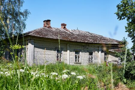 A typical village house in the countryside in Russia in a summer or spring day