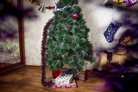 Christmas tree with presents in the room. Holiday of Christmas or New Year