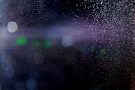Abstract white blurred dust explosion and flash with illumination on a black background