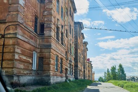 View of the facade of an old red brick house in a city, town or big village in a sunny day