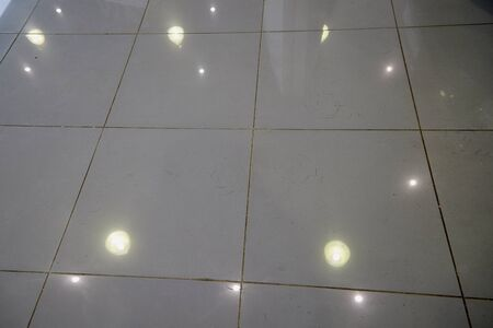 Abstract mirror mosaic background. Shiny tiles on the floor and light Stockfoto