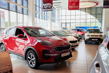 Murmansk, Russia - June 21, 2019: Cars in showroom of dealership KIA in Murmansk city in Russia