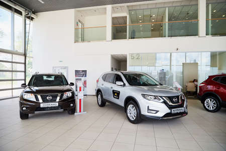 Vologda, Russia - June 18, 2019: Cars in showroom of dealership Nissan in Vologda city in Russia