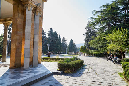 Gori, Georgia - October 22, 2019: The museum of the soviet union's dictator and ruler Stalin and the little house where he was born among the big columns