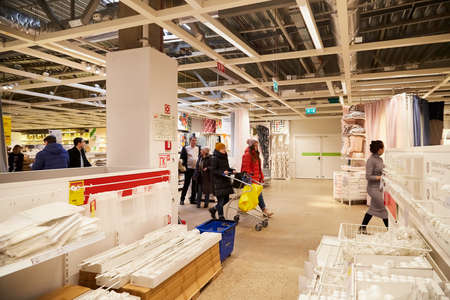 Kazan, Russia - December 22, 2019: Interior in hall of large IKEA store with a wide range of products and people in it in Russia Sajtókép