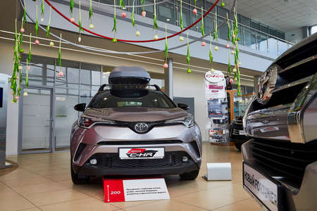 Murmansk, Russia - June 21, 2019: Cars in showroom of dealership Toyota in Murmansk city in Russia