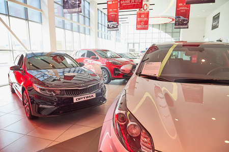 Murmansk, Russia - June 21, 2019: Cars in showroom of dealership KIA in Murmansk city in Russia