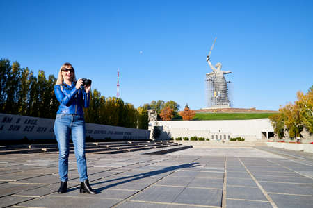 Volgograd, Russia - October 18, 2019: Tourist in park of historical war complex Mamaev Kurgan in Volgograd, Russia