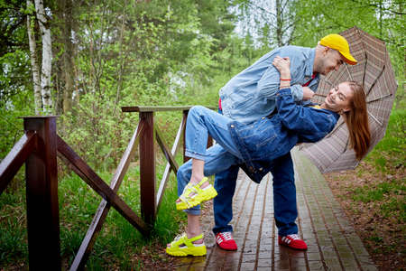 Kirov, Russia - June 22, 2020: European couple of blonde woman and bald man walking at park, enjoying and being happy together. Love and tenderness concept. Lovers on date outdoors at nature Stockfoto