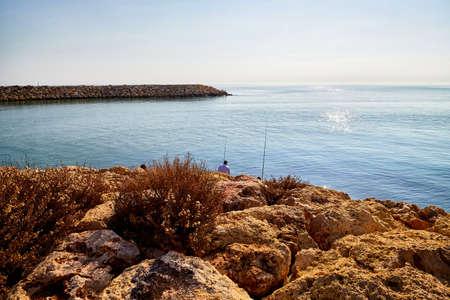 Rocky coast, sea, sky and horizon in the background. Landscape in Antalya