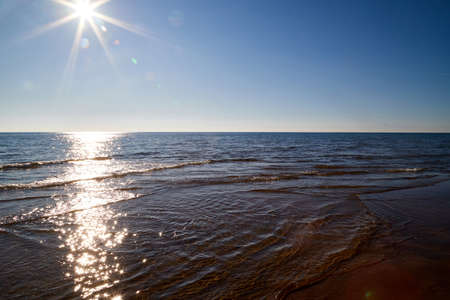 Water of sea and sky bright sun looking as star