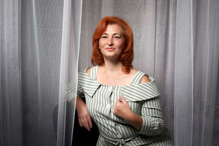 Portrait of Attractive Old woman with beautiful ginger hair