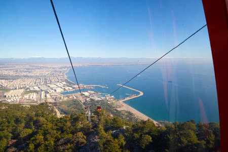 Cable Car in the mountain and blue sea background in sunny day in Turkey