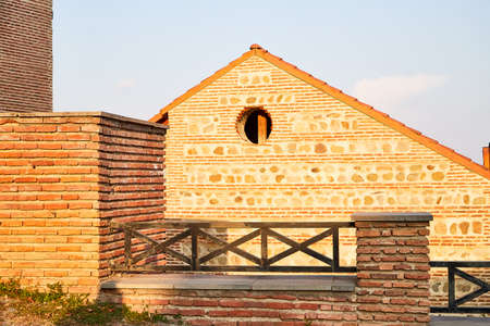 Roof of Old house with yellow stones and bricks in the mountains. Orthodox church in Nekresi Monastery located in Georgia