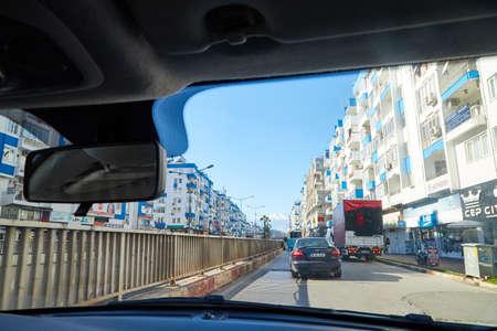 Antalya, Turkey - December 19, 2019: View from the car window on the street of the modern city of Antalya in Turkey