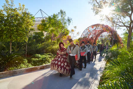 Antalya, Turkey - December 17, 2019: Animators and actors in beautiful clothes on the alley among the trees in the Land of legends Park in Turkey in Belek