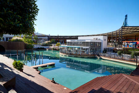 Antalya, Turkey - December 17, 2019: Pool with green water on a Sunny day in the Park