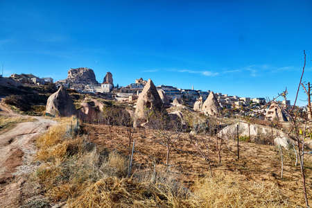 View on Cappadocia rock houses, caves and ruins in Goreme in Anatolia, Turkey. Ruins of an ancient city. Concept of the historic voyage