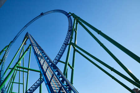Roller coaster Ride against blue sky in a nice sunny day