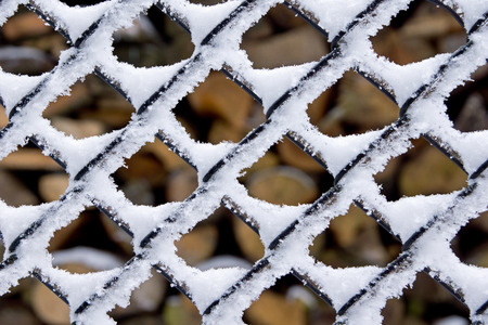 Frosty fence - winter texture photo