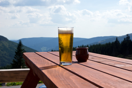 Glass of beer on a table 写真素材