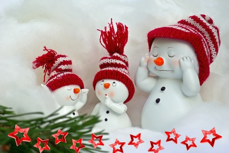 Snowman with beautiful red cap photo