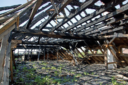 Ruin with burnt wood roof photo