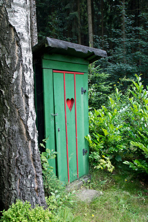 outhouse: Rural old outhouse in summer Stock Photo