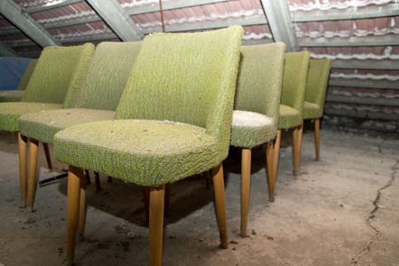 urban decline: Old chairs in the loft, lost place Stock Photo